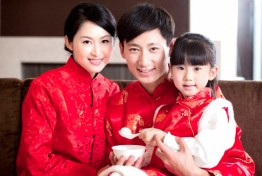 Portrait of Chinese Family Sharing Dumpling On Chinese New Year, Smiling