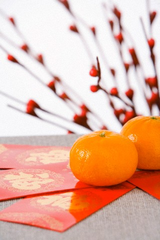 Red Packets Containing Monetary Gifts With Mandarin Oranges