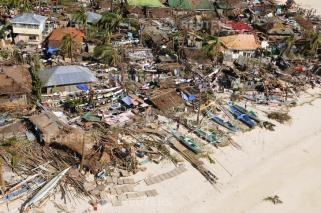 An aerial view shows damaged houses on a coastal community, after Typhoon Haiyan hit Iloilo Province