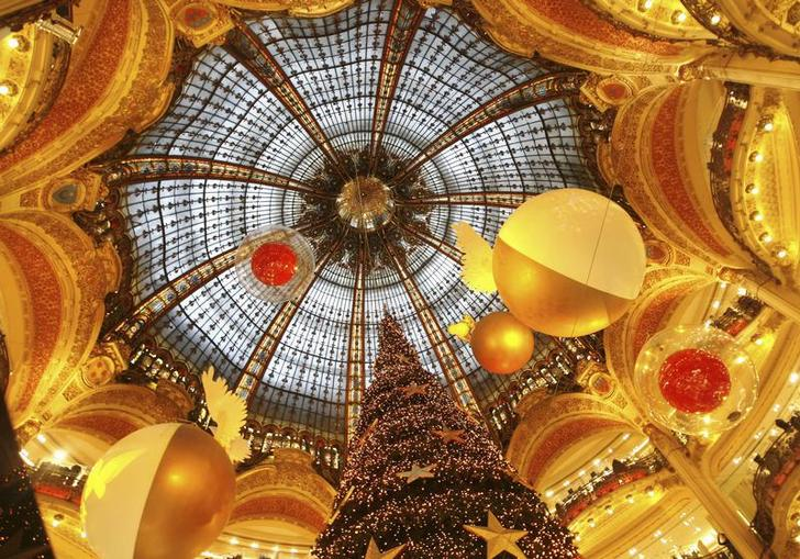 A giant Christmas tree stands in the middle of Galeries Lafayette department store as the French capital prepares for the holiday season