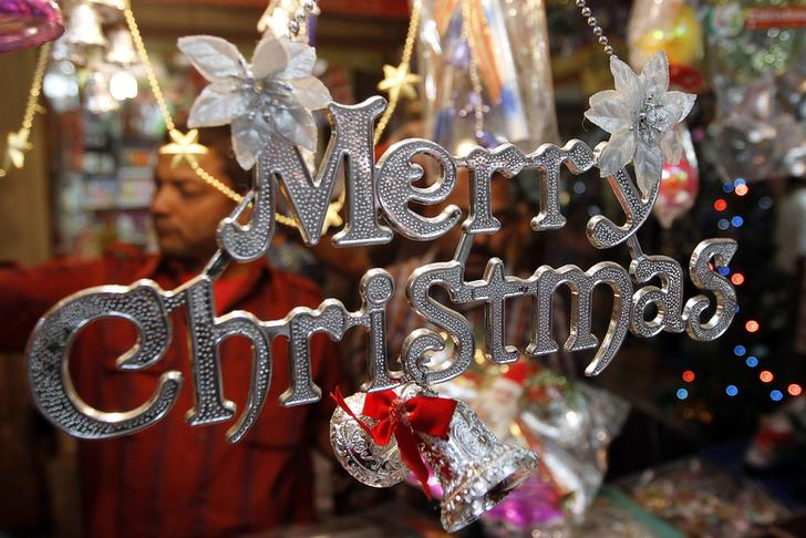 Christmas decorations on sale hang at a roadside stall in Ahmedabad
