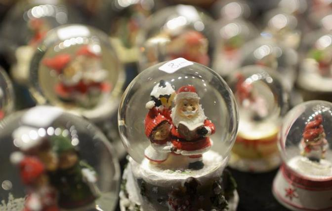 Snow globes featuring Santa Claus are displayed at a booth at the Christmas market in Hamburg
