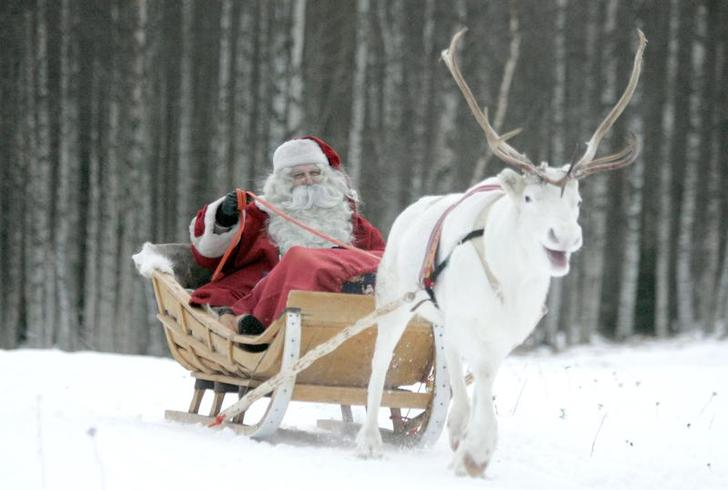 A man dressed as Santa Claus rides his sleigh as he prepares for Christmas on the Arctic Circle in Rovaniemi, northern Finland