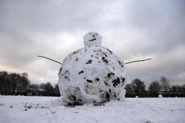 A snowman is seen on Wandsworth Common after heavy snow falls in London