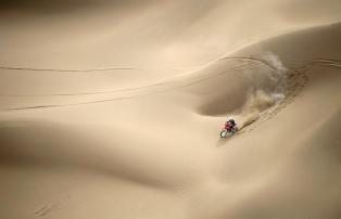 Wang Yirong of Hebei province rides his motorcycle in a desert during the China Taklimakan Rally and CCR Xinjiang Station, in Shanshan, Xinjiang Uighur Autonomous Region May 31, 2014. REUTERS/China Daily (CHINA - Tags: SPORT MOTORSPORT TPX IMAGES OF THE DAY) CHINA OUT. NO COMMERCIAL OR EDITORIAL SALES IN CHINA
