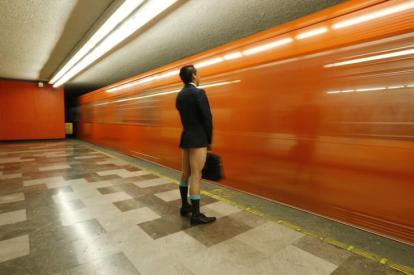 """A passenger without pants waits for the subway train during """"The No Pants Subway Ride"""" in Mexico City January 11, 2015. The event, the fifth organized in Mexico, is an annual flash mob and occurs in different cities around the world, according to its organisers. REUTERS/Edgard Garrido (MEXICO - Tags: TPX IMAGES OF THE DAY SOCIETY TRANSPORT)"""