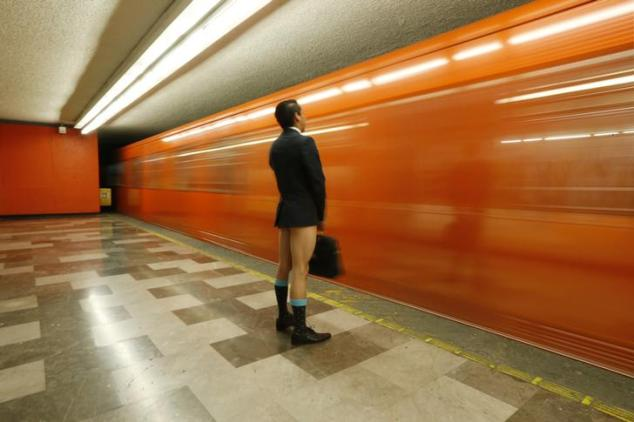 "A passenger without pants waits for the subway train during ""The No Pants Subway Ride"" in Mexico City January 11, 2015. The event, the fifth organized in Mexico, is an annual flash mob and occurs in different cities around the world, according to its organisers. REUTERS/Edgard Garrido (MEXICO - Tags: TPX IMAGES OF THE DAY SOCIETY TRANSPORT)"