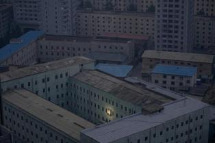 A picture of North Korea's founder Kim Il-sung decorates a building in the capital Pyongyang early in this October 5, 2011 file photo. REUTERS/Damir Sagolj/Files (NORTH KOREA - Tags: CITYSCAPE SOCIETY TPX IMAGES OF THE DAY) ATTENTION EDITORS - THIS PICTURE IS PART OF PACKAGE '30 YEARS OF REUTERS PICTURES' TO FIND ALL 56 IMAGES SEARCH '30 YEARS'