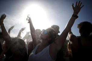 People cool off in misters at the Coachella Valley Music and Arts Festival in Indio, California April 12, 2015. REUTERS/Lucy Nicholson