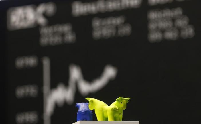 Foam figures of bulls, the symbol for a positive trend at stock markets, are pictured as the curve reaches a new all time high on the German share price index DAX board at the stock exchange in Frankfurt, October 15, 2013. Germany's DAX reached a new all time high earlier today. REUTERS/Kai Pfaffenbach (GERMANY - Tags: ANIMALS BUSINESS)