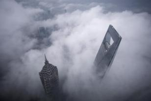 Skyscrapers Shanghai World Financial Center (R) and Jin Mao Tower are seen during heavy rain at the financial district of Pudong in Shanghai May 15, 2015. REUTERS/Aly Song TPX IMAGES OF THE DAY