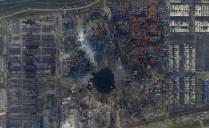 An aerial picture of the site of explosions at the Binhai new district, Tianjin, China, August 16, 2015. The explosions late last Wednesday in the world's 10th-busiest port in China's industrial northeast, forced the evacuation of thousands of people after toxic chemicals were detected in the air. More than 700 people were injured and another 70, mostly fire fighters, are still missing. The blasts devastated a large industrial site and nearby residential areas. Picture taken August 16, 2015. REUTERS/Stringer CHINA OUT. NO COMMERCIAL OR EDITORIAL SALES IN CHINA TPX IMAGES OF THE DAY