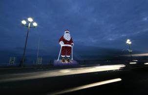 A giant illuminated Santa Claus is seen on the Promenade Des Anglais as part of holiday season decorations in Nice, France, December 14, 2015. REUTERS/Eric Gaillard