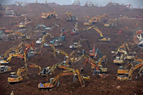 Excavators are seen during rescue operations at an industrial estate hit by a landslide in Shenzhen, Guangdong province, December 23, 2015. REUTERS/Kim Kyung-Hoon TPX IMAGES OF THE DAY