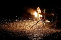 """Fishermen use a fire to attract fish on a traditional """"sulfuric fire fishing"""" boat in New Taipei City, Taiwan June 19, 2016. REUTERS/Tyrone Siu SEARCH """"FIRE FISHING"""" FOR THIS STORY. SEARCH """"THE WIDER IMAGE"""" FOR ALL STORIES. TPX IMAGES OF THE DAY"""