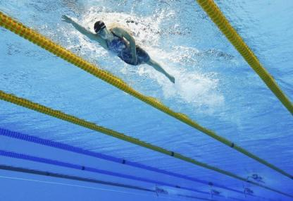2016 Rio Olympics - Swimming - Final - Women's 800m Freestyle Final - Olympic Aquatics Stadium - Rio de Janeiro, Brazil - 12/08/2016. Katie Ledecky (USA) of USA competes on her way to winning the gold and setting a new world record. REUTERS/Stefan Wermuth TPX IMAGES OF THE DAY FOR EDITORIAL USE ONLY. NOT FOR SALE FOR MARKETING OR ADVERTISING CAMPAIGNS.