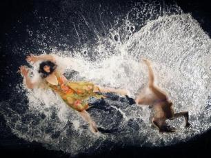 Dancers perform on a transparent overhead water stage during a media preview and dress rehearsal for the Fuerzabruta (Brute Force) show, created by Diqui James of Argentina, in Taipei December 14, 2009. The show, which features a semi-interactive presentation form including a floating water pool above the audience, will run from December 15 to January 24. REUTERS/Nicky Loh (TAIWAN - Tags: ENTERTAINMENT SOCIETY)
