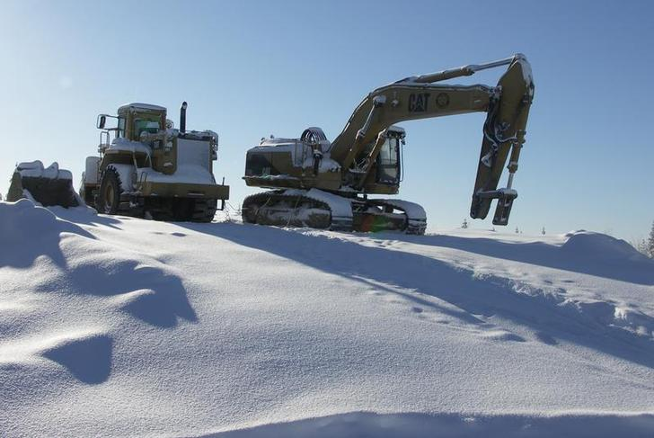 A drilling machine (R) and a dump truck are seen during the drilling of a winter test pit in an unknown location February 22, 2005. Just a few years ago, mining was in decline in Sweden and much of the sparsely populated, forested north looked like being left to logging companies and the native moose and reindeer. But thanks to strong demand for metals and rocketing prices, copper, zinc, gold and silver mining are undergoing a rebirth. Mining companies will invest more than 30 million euros ($35 million) in exploration in Sweden this year, mainly in the north, according to estimates by the Raw Materials Group (RMG) consultancy, up from around 25 million euros in 2004. Photo taken February 22, 2005. To match feature Minerals-Sweden. REUTERS/Lappland Goldminers/Handout