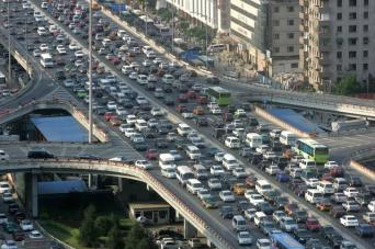 A traffic jam is seen during the rush hour in Beijing June 14, 2006. China needs to improve public transport to help curb choking traffic jams instead of building more and more highways to make room for private cars, the World Bank said on Wednesday. REUTERS/ Jason Lee (CHINA)