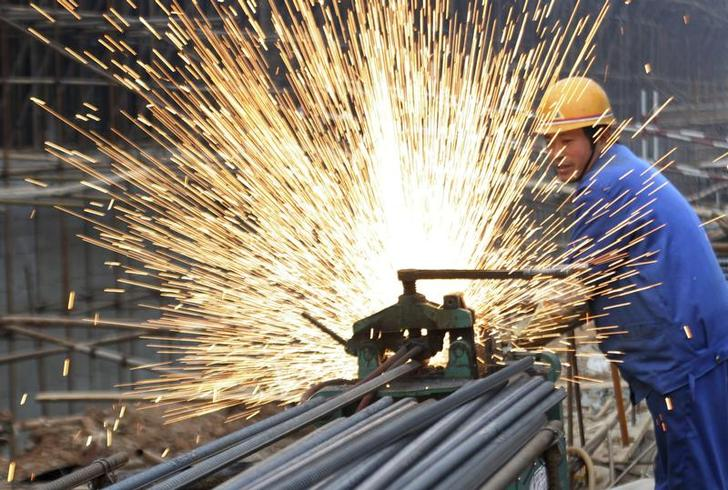 A labourer welds steel bars at a construction site in Huaibei, east China's Anhui province, December 31, 2006. China has raised the threshold for steel mills and trading firms to qualify for imports of iron ore in an effort to help curb inflows of the raw material to outdated steel mills, the industry body said on Thursday. CHINA OUT REUTERS/China Daily (CHINA)