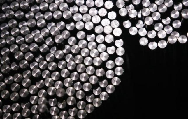 Cold drawn steel bars are pictured at a production line at 'Schmolz + Bickenbach' group in Duesseldorf March 12, 2008. 'Schmolz + Bickenbach' group one of the world's largest manufacturers, processors and distributors of special steel long products. REUTERS/Ina Fassbender (GERMANY)