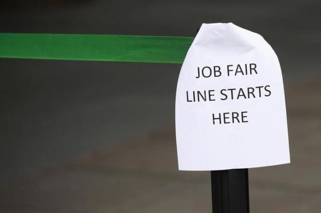 A sign marks the entrance to a job fair in New York October 24, 2011. High unemployment, not inflation, is the biggest problem facing the U.S. economy today, a top Federal Reserve official known for his hawkish views on inflation said on Monday. REUTERS/Shannon Stapleton (UNITED STATES - Tags: BUSINESS EMPLOYMENT)