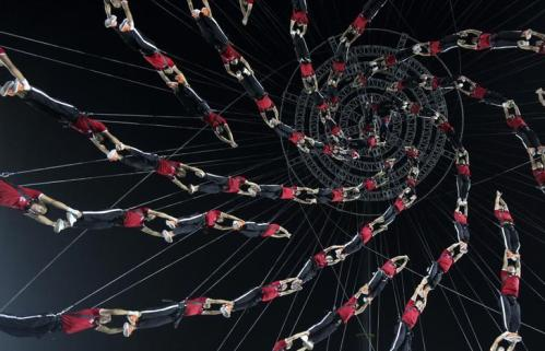 """Students of Shaolin Tagou Martial Arts School are suspended in mid-air as they practise in a dress rehearsal for a stunt performance which is part of the opening ceremony of the 2014 Nanjing Youth Olympic Games, at a stadium in Nanjing, Jiangsu province August 14, 2014. A total of 520 students took part in the performance named """"Building the dream"""", which will be performed during the opening ceremony of the Youth Olympic Games on August 16, local media reported. Picture taken August 14, 2014. REUTERS/Stringer (CHINA - Tags: SPORT SOCIETY OLYMPICS TPX IMAGES OF THE DAY) CHINA OUT. NO COMMERCIAL OR EDITORIAL SALES IN CHINA"""