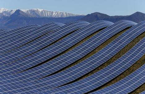 A general view shows solar panels to produce renewable energy at the photovoltaic park in Les Mees, in the department of Alpes-de-Haute-Provence, southern France March 31, 2015. The solar farm of the Colle des Mees, the biggest in France, consists of 112,780 solar modules covering an area of 200 hectares of land and representing 100 MW of power. REUTERS/Jean-Paul Pelissier