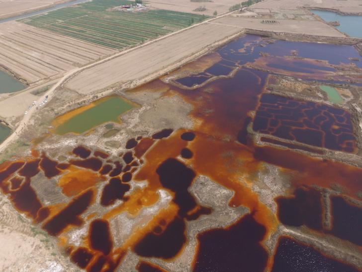 Land polluted by industrial wastewater is seen in an aerial photo in Langfang, Hebei province, China April 20, 2017. Picture taken April 20, 2017. REUTERS/Stringer ATTENTION EDITORS - THIS IMAGE WAS PROVIDED BY A THIRD PARTY. EDITORIAL USE ONLY. CHINA OUT. NO COMMERCIAL OR EDITORIAL SALES IN CHINA.