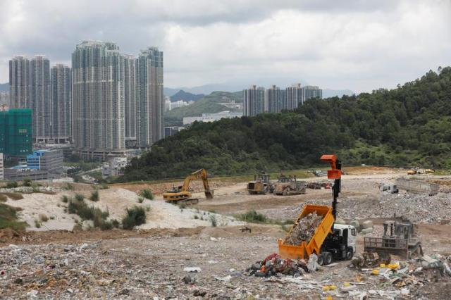 A truck unloads garbage at a landfill at Tseung Kwan O district in Hong Kong, China June 9, 2017. Picture taken June 9, 2017. REUTERS/Tyrone Siu