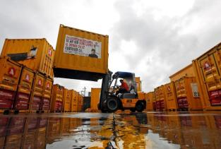A forklift operator stacks containers at the godown of Agarwal Packers and Movers Ltd. on the outskirts of Mumbai, India June 29, 2017. REUTERS/Shailesh Andrade