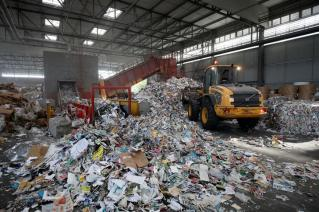 A wheel loader is used to move paper waste to be recycled at Veolia Proprete France Recycling company in Gennevilliers, near Paris, France August 24, 2017. REUTERS/Benoit Tessier
