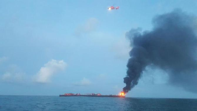 Coast Guard responds to barge on fire approximately three miles from Port Aransas jetties in Texas, U.S., October 20, 2017. Courtesy U.S. Coast Guard/Handout via REUTERS ATTENTION EDITORS - THIS IMAGE HAS BEEN SUPPLIED BY A THIRD PARTY.