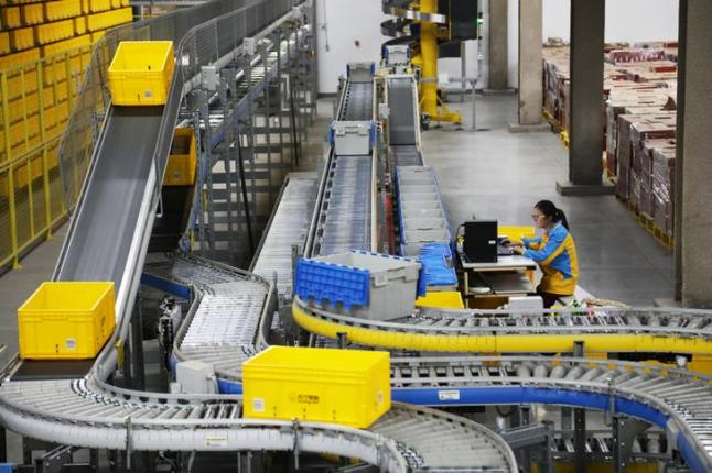 An employee works at a logistics base of Suning ahead of the Singles Day online shopping festival in Nanjing, Jiangsu province, China November 7, 2017. Picture taken November 7, 2017. REUTERS/Stringer ATTENTION EDITORS - THIS IMAGE WAS PROVIDED BY A THIRD PARTY. CHINA OUT.