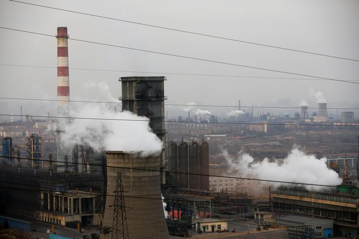 Cooling towers emit steam and chimneys billow in an industrial zone in Wu'an, Hebei province, China, February 20, 2017. Picture taken February 20, 2017. REUTERS/Thomas Peter