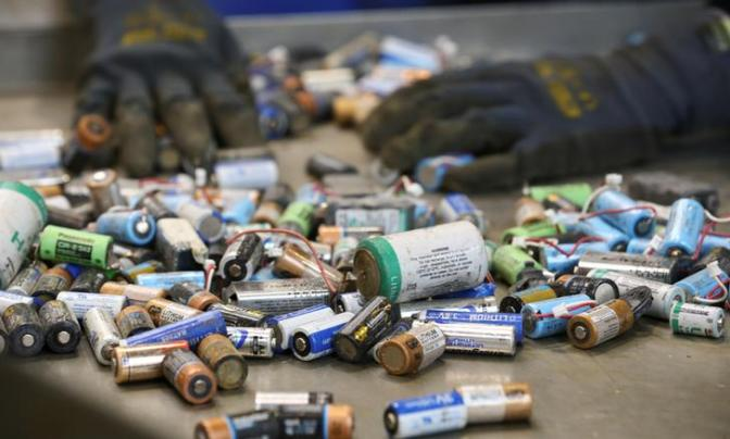 An employee sorts used primary non-rechargeable Lithium-ion batteries before being recycled by the German recycling firm Accurec in Krefeld, Germany, November 16, 2017. Picture taken November 16, 2017. REUTERS/Wolfgang Rattay