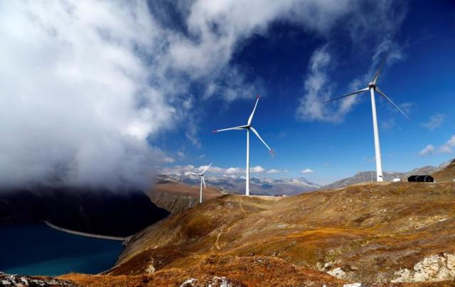 Wind turbines are pictured at Swisswinds farm, Europe's highest wind farm at 2500m, before the topping out ceremony near the Nufenen Path in Gries, Switzerland September 30, 2016. REUTERS/Denis Balibouse