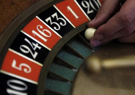 A young croupier trainee turns the roulette at a gaming table at the Cerus Casino Academy in Marseille November 6, 2013. Cerus Academy is the only school in France authorized to issue the official croupier certificate. REUTERS/Jean-Paul Pelissier (FRANCE - Tags: SOCIETY BUSINESS EMPLOYMENT)