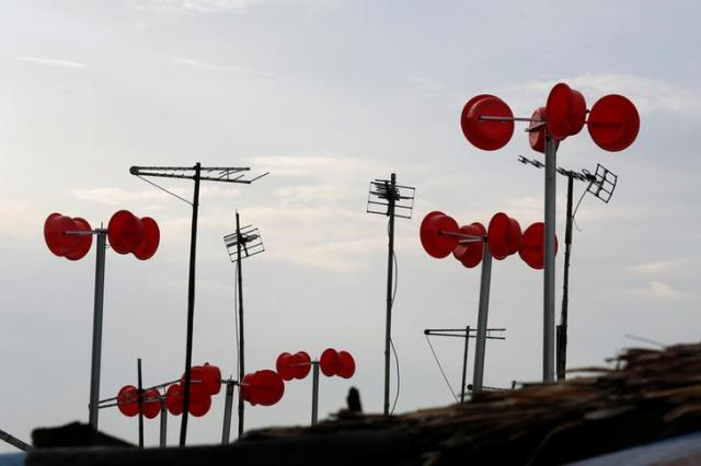 A wind power system made from plastic buckets is seen on boats at a floating village in Hanoi, Vietnam June 29, 2016. Picture taken on June 29, 2016, REUTERS/Kham