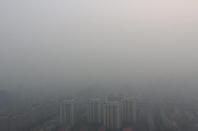 Residential buildings are seen in smog during a polluted day in Beijing, China, February 4, 2017. REUTERS/Stringer ATTENTION EDITORS - THIS PICTURE WAS PROVIDED BY A THIRD PARTY. EDITORIAL USE ONLY. CHINA OUT. NO COMMERCIAL OR EDITORIAL SALES IN CHINA.