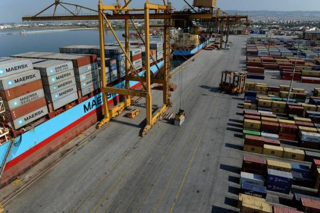 A container is prepared to be loaded on a cargo ship at the commercial terminal of the port of the northern city of Thessaloniki, Greece August 5, 2016. Picture taken August 5, 2016. REUTERS/Alexandros Avramidis