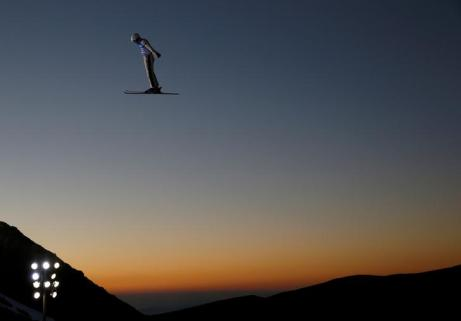"""Qi Guangpu of China performs an aerial in the Men's Aerials training during the FIS Snowboarding and Freestyle Skiing World Championships in Sierra Nevada, Spain, March 9, 2017. REUTERS/Paul Hanna/File Photo SEARCH """"POY SPORT"""" FOR THIS STORY. SEARCH """"REUTERS POY"""" FOR ALL BEST OF 2017 PACKAGES. TPX IMAGES OF THE DAY"""