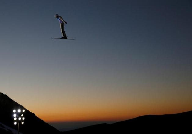 "Qi Guangpu of China performs an aerial in the Men's Aerials training during the FIS Snowboarding and Freestyle Skiing World Championships in Sierra Nevada, Spain, March 9, 2017. REUTERS/Paul Hanna/File Photo SEARCH ""POY SPORT"" FOR THIS STORY. SEARCH ""REUTERS POY"" FOR ALL BEST OF 2017 PACKAGES. TPX IMAGES OF THE DAY"