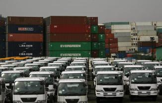 New container trucks are parked in front of a container storage depot in north-west Hong Kong February 18, 2009. The 17 major storage depots in the territory were filled to their 160,000-containers capacity as the government looks for more places to store hundreds of thousands of unused shipping containers expected to flood Hong Kong in the coming months, due to China's slowing exports, brought forth by the global financial crisis, South China Morning Post reported. REUTERS/Bobby Yip (CHINA)